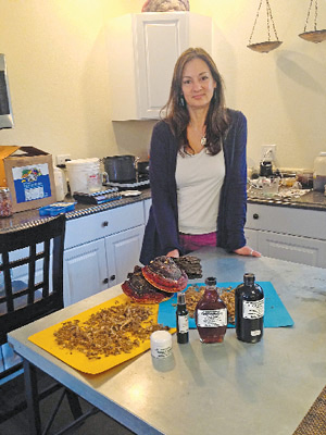 Jules Pescon creates tinctures and salves in her kitchen/lab in Paradise.